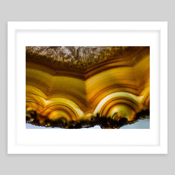 White framed art print of a close-up photograph of a crystal or mineral showing the detailed coloration