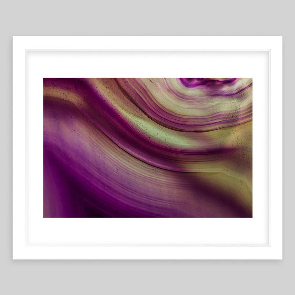 White framed art print of a photograph showing a purple and yellow pattern