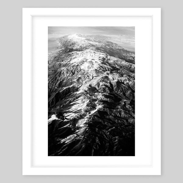 White framed art print of a black & white photograph of a rocky mountain top