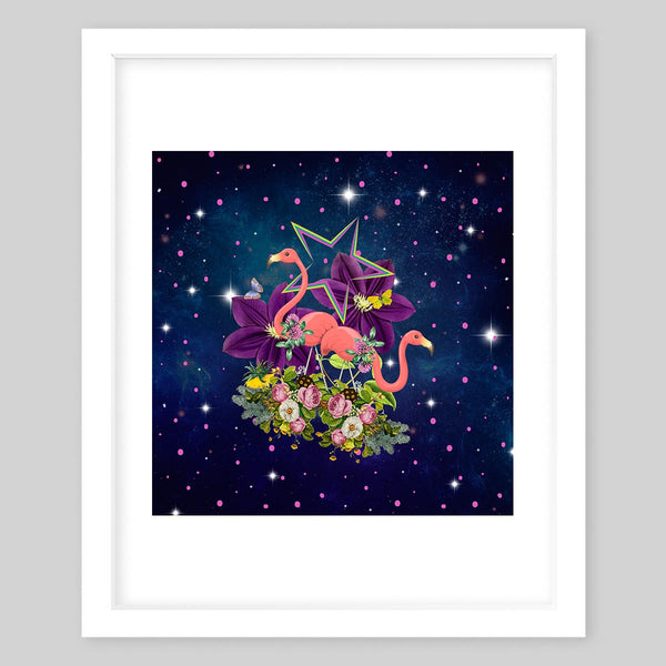 White framed art print of a collage featuring two flamingos as they stand in between flowers and foliage in the center of space surrounded by stars
