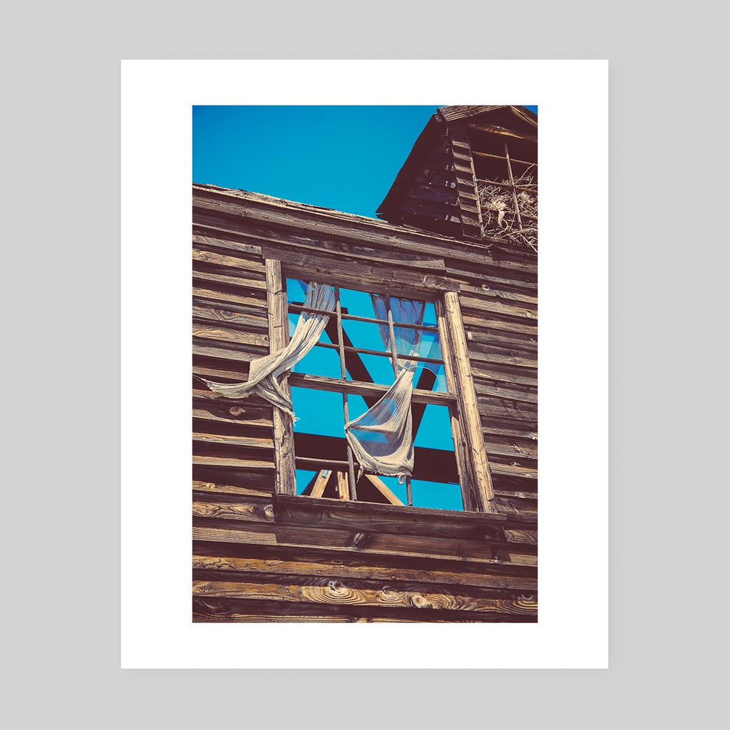 Art print of a photograph of the glass-less window of an old, rustic abandoned house