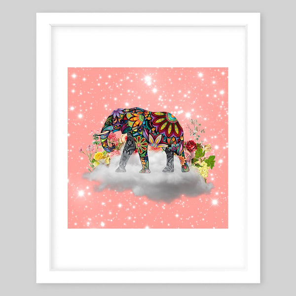 White framed art print of a collage featuring a mandala printed elephant on top of a cloud with flowers against a sparkly pink background