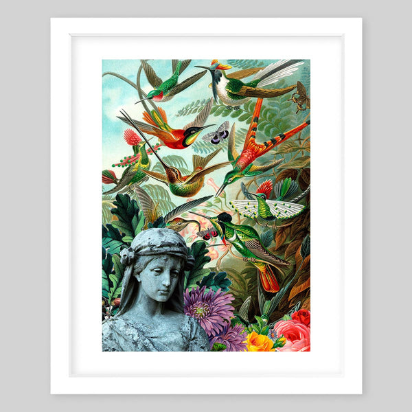 White framed art print of a collage featuring a sculpture surrounded by various flowers, trees and plants