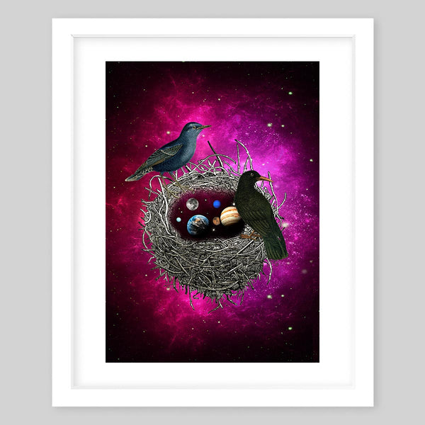 White framed art print of a collage featuring two birds sitting on top of a nest in space with eggs that resemble planets