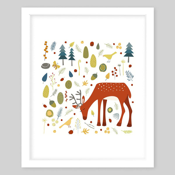 White framed art print of the illustration centered on a deer and a pattern of leaves, nuts, trees, and small animals in the background