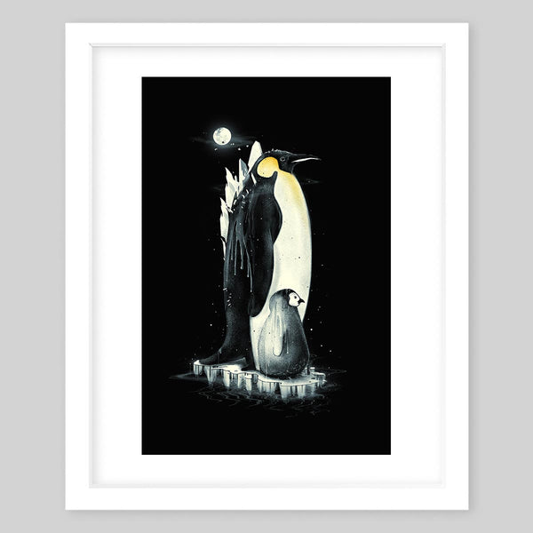 White framed art print of two emperor penguins, one small one large, standing on a small sledge of ice in the dark