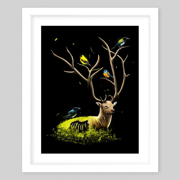 White framed art print of an elk laying in a bed of green moss with birds on its antlers and body and a hole on its lower body where the ribs are visible