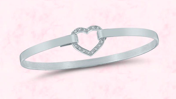 Share your favorite moment with Mom for a chance to win our handmade silver and diamond heart bracelet.