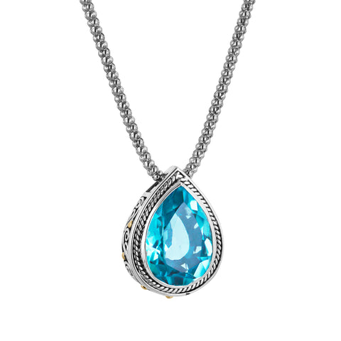 Pear shaped blue gemstone sterling silver pendant with 18K gold accents