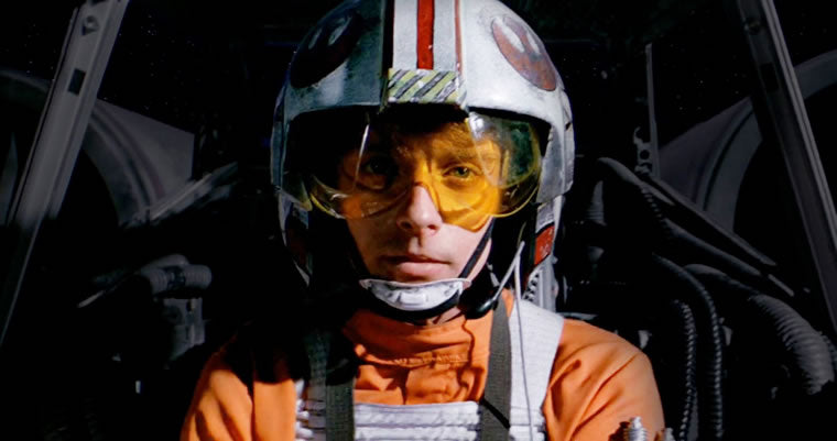 Luke Skywalker wearing iconic helmet in X-Wing