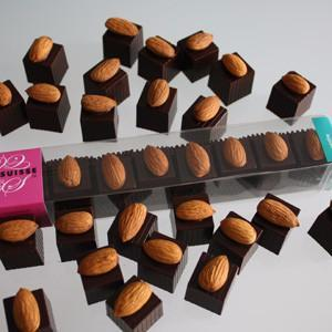 These gorgeous Coco Suisse Croquantine chocolates make for a perfect confectionery gift or personal indulgence. The triumphant combination of the finest hazelnut gianduja and croquantine crisp filling, surrounded by dark Swiss chocolate and topped with a roasted California almond, will delight your senses and satisfy your chocolate cravings.
