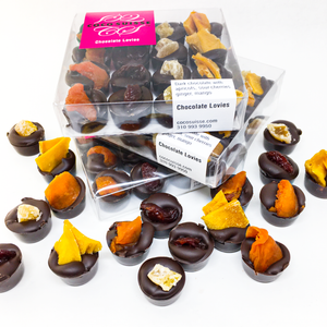Coco Suisse Chocolate Lovies are made with dark Swiss chocolate and are topped with sour cherry, apricot, ginger, and mango. Share the Lovie!