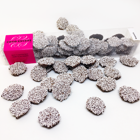 The Ultimate throwback to childhood, but now made with the finest quality ingredients and craftsmanship in the world. These classic Coco Suisse Nonpareils are dark Swiss chocolate buttons topped with crunchy nonpareils. While just looking at them will put a childlike smile on your face, eating them will satisfy your senses with magnificent Swiss chocolate flavors.