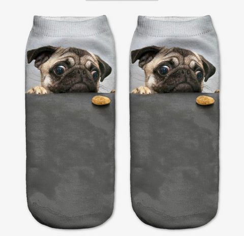 Socks with a picture of a cute pug looking at a cookie.