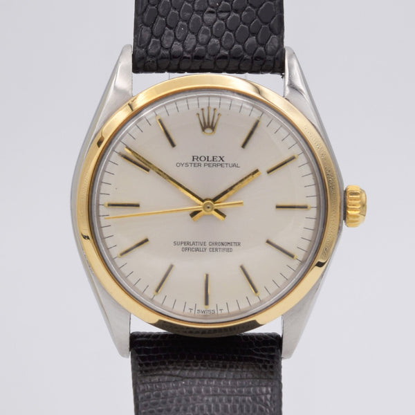 ROLEX OYSTER PERPETUAL STAINLESS WITH GOLD BEZEL