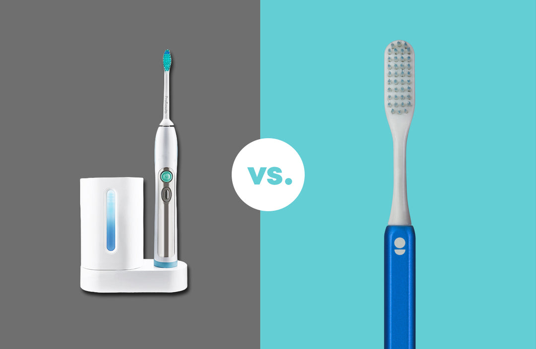 Photo of an electric toothbrush and manual toothbrush