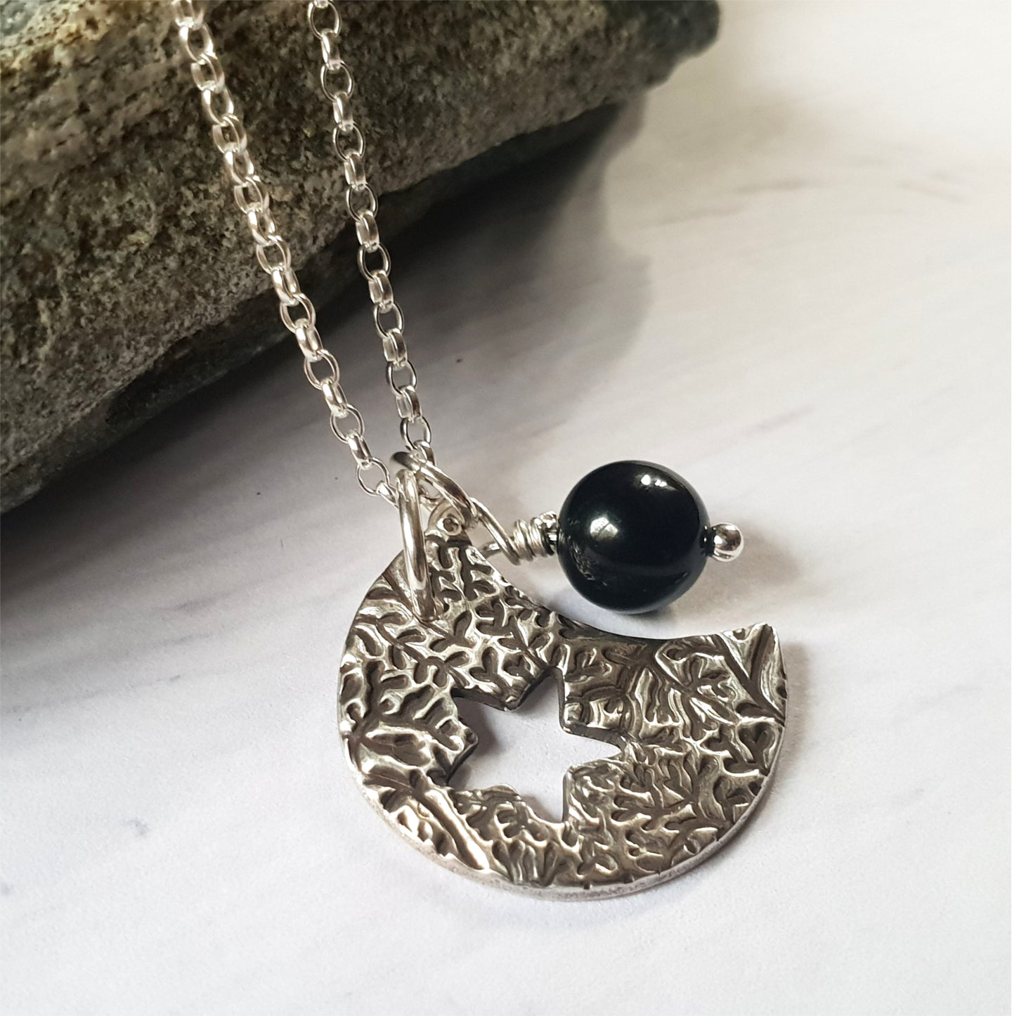 Black tourmaline silver moon necklace.