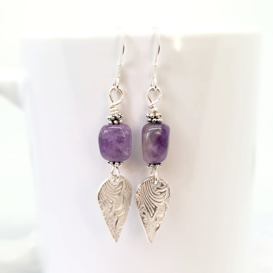 Dangly silver and amethyst earrings.
