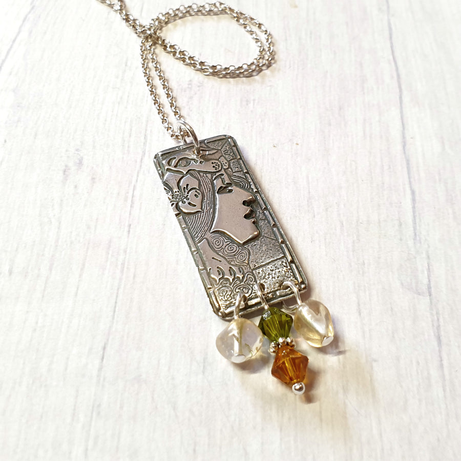 Silver fairy folk necklace with citrine gemstones.