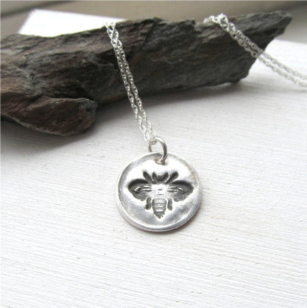Silver honey bee necklace.