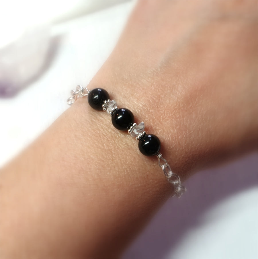 Black tourmaline wrapped gemstone bracelet.