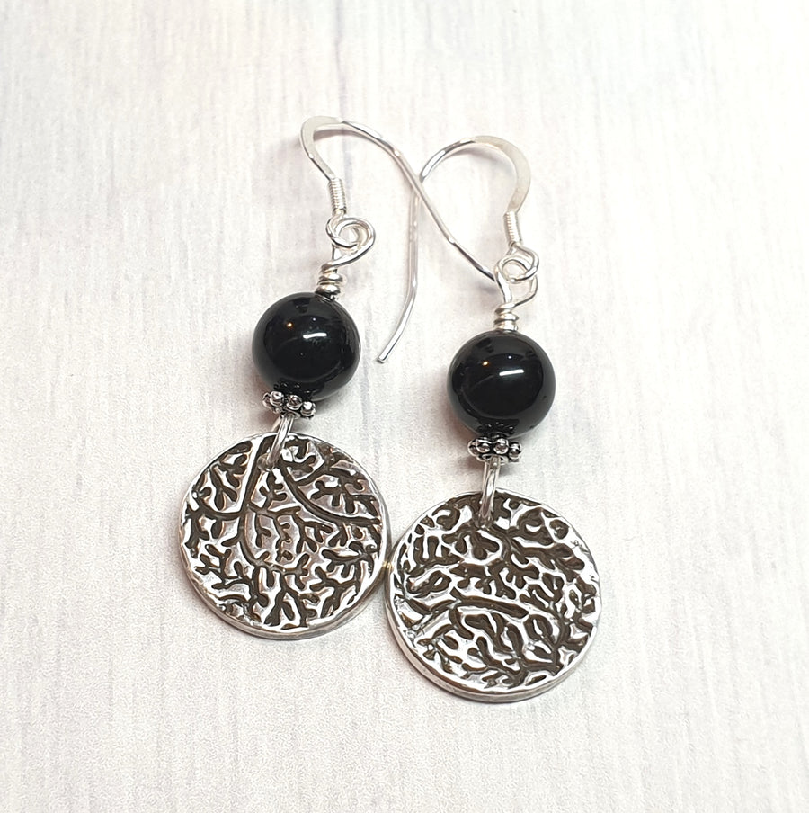 Artisan black tourmaline and silver earrings.