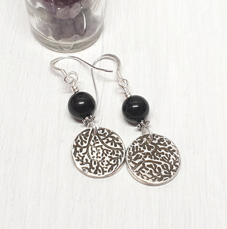 Silver and black tourmaline dangle earrings.