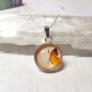 Whimsical butterfly necklace in sterling silver.