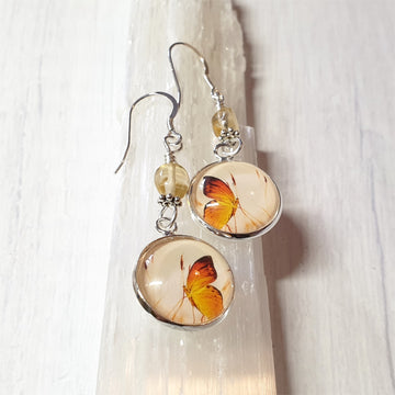 Butterfly earrings with citrine gemstones.