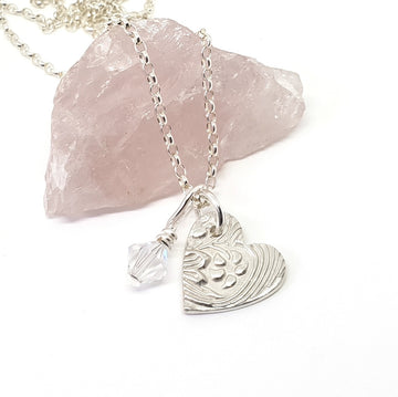 Delicate silver heart necklace.