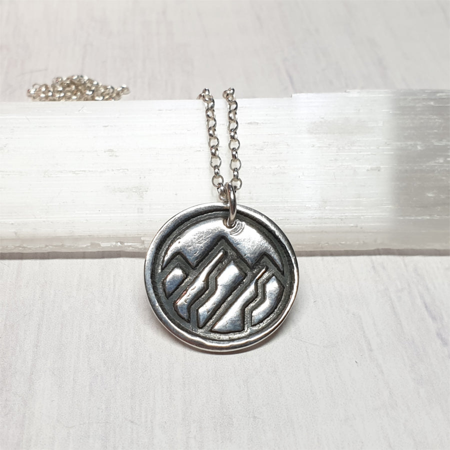 Mountain earth element silver pendant necklace.