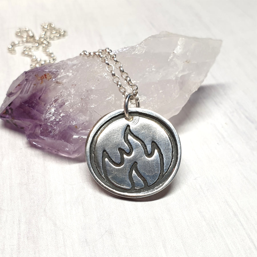 Silver fire element symbolic necklace.