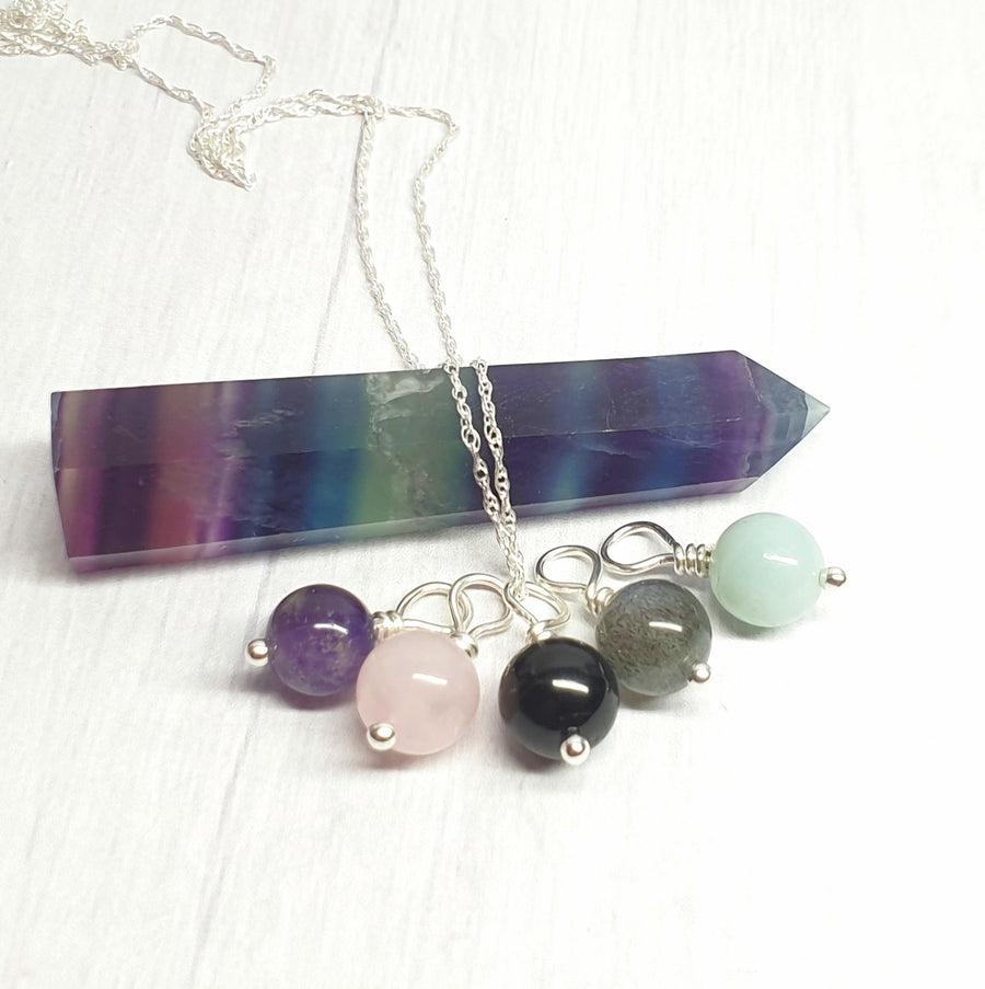 Mutli gemstone pendant set with sterling chain.