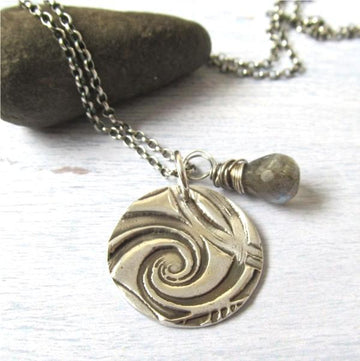 Silver spiral necklace with labradorite gemstone.