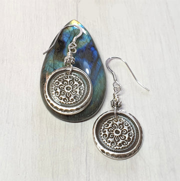 Silver mandala earrings.