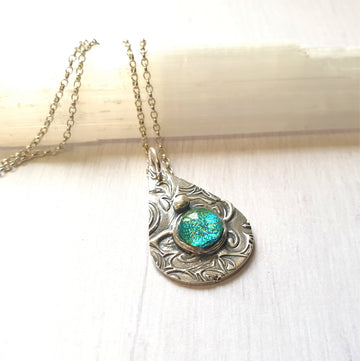 Silver mermaid waves necklace.