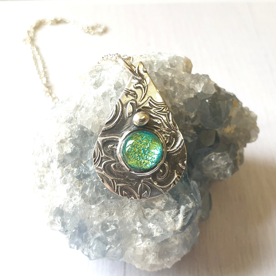 Inner mermaid glowing blue necklace.
