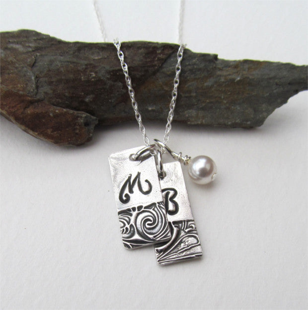 Personalised initial necklace.