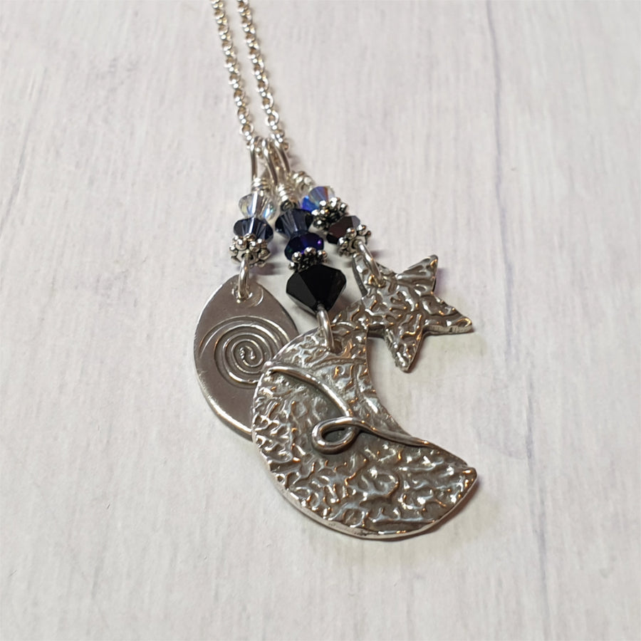 Three in one sterling celestial charm necklace.