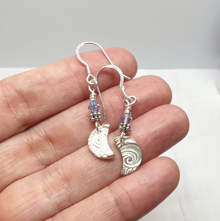 Sterling silver crescent moon earrings.