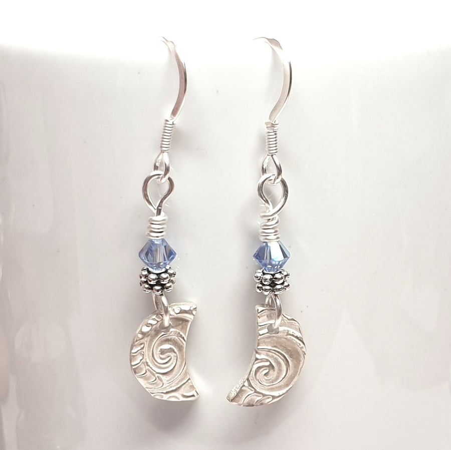 Dangly moon earrings with blue crystals.