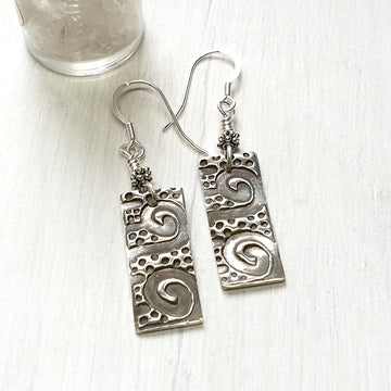 Silver ocean wave earrings.