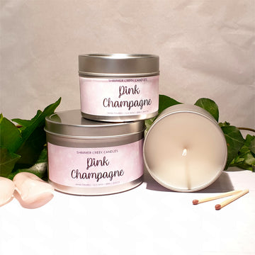 Pink champagne soy wax candle tin.