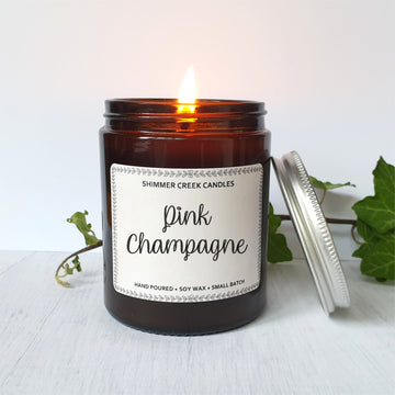 Pink champagne scented soy wax candle.
