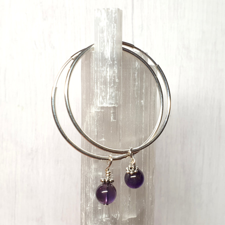 Bold and beautiful sterling silver hoop earrings.