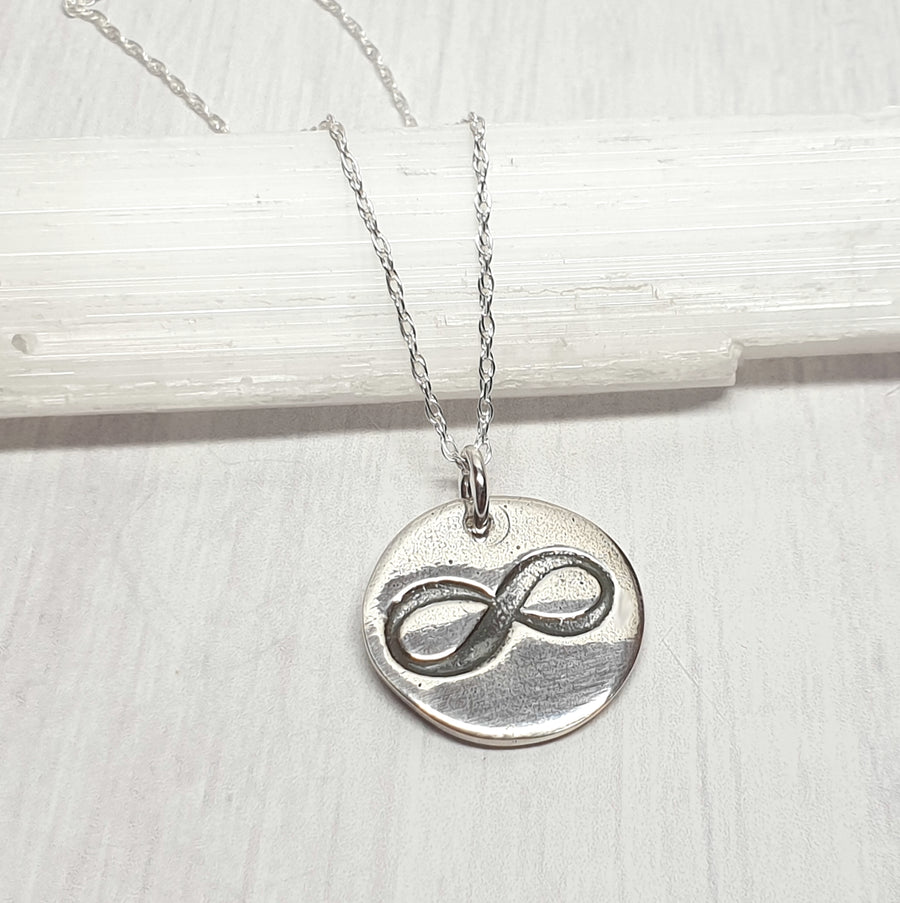 Infinity symbol necklace in sterling silver.