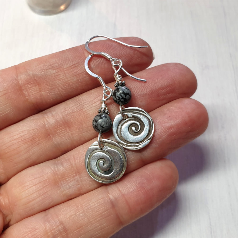 Sterling silver and gemstone earrings.