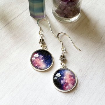 Silver nebula star earrings.