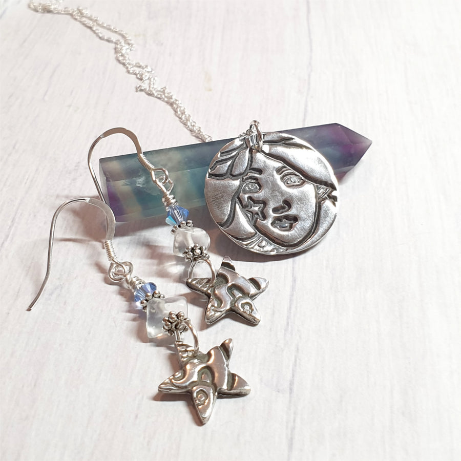 Whimsical stargzer necklace and earring set with star woman and star earrings.