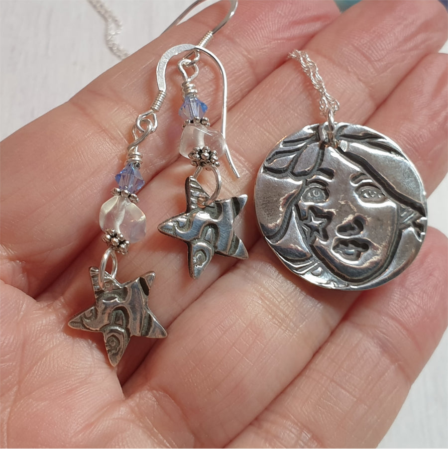 Stargazer silver earrings and necklace set.